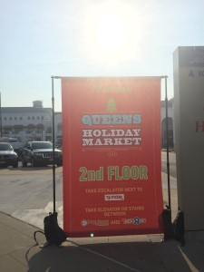 Billboards are seen trying to guide and attract people to attend the holiday market.