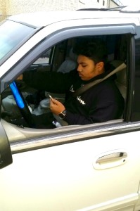 Brandon Surujbali demonstrates distracted driving. Photo Credit: Vernon Surujbali
