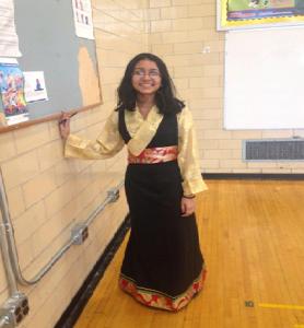"Emily Lachuu in a traditional Tibetan ""Chupa"""
