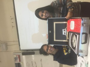Annicia Bisnauth and Reya Bhoodai from Model UN showing us a model of Shop In a Box.