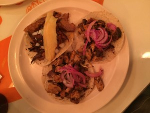 Spicy chicken tacos labeled as Pollo Yucateco on the menu.