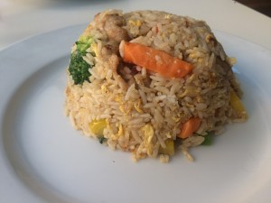 A clean plate of Spicy Basil Fried Rice.