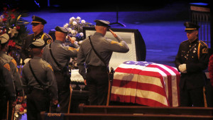 Police officers mourning the death of fellow officers, who were victims against violent acts. Photo Credits: Barbara Davidson / Los Angeles Times