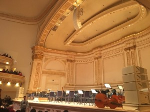 Carnegie Hall's stage is filled with seats and open music scores, awaiting to be filled with musicians to fill the theater with melodies. Photo Credit: Marilyn Ramos​​