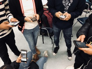 Caption: This photo shows a group of friends who are too interested with their phones to actually hang out and converse among each other. Picture Credit: Rachel Rasul