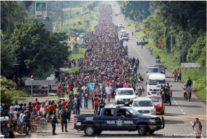 Central American migrants walk along the highway near the border with Guatemala, as they continue their journey trying to reach the U.S., in Tapachula, Mexico Oct. 21, 2018