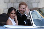 Photo Caption: Prince Harry and Meghan Markle after the celebration of their wedding. Photograph: REX/Shutterstock